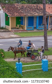 Pinar del Rio, Cuba - january 21, 2016: View from the top of a group of peasants on bicycles and horse carts gathered in a street of the town of Vinales