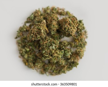Pinch of Cannabis in circle shape on white background
