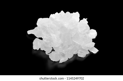 A Pinch of Coarse Sea Salt Closeup Ready for Grind Mill or Cooking or Therapeutic. Can be Used for Logotype. Isolated on Black Background.