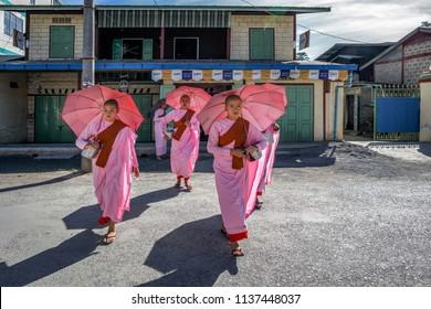 Pindaya, Myanmar, 20 NOVEMBER 2016 : Buddhist nuns walking for morning alms on street, Myanmar.