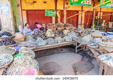 PINDAYA, MYANMAR - FEBRUARY 27:  Women are selling dried fish of all kind at the local market on February 27, 2012 in Pindaya, Myanmar.