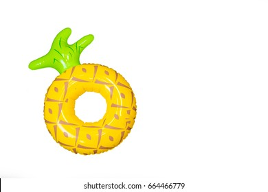 A pine apple pool floats isolate in white background with copy space. (summer time concept)
