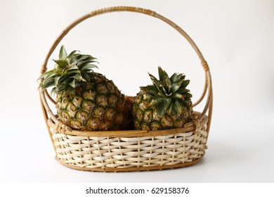 pine apples on basket