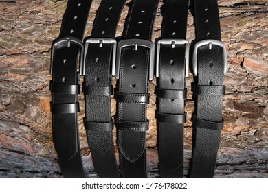 pine bark covered with black leather belts for men