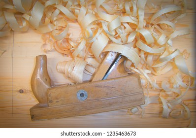 Pine board with planer and shavings