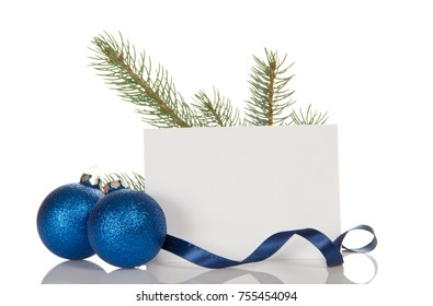 Pine branch, two Christmas balls-toys, blank card, isolated on white background