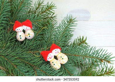 Pine Branches And Wooden Christmas Decorations On A White Background