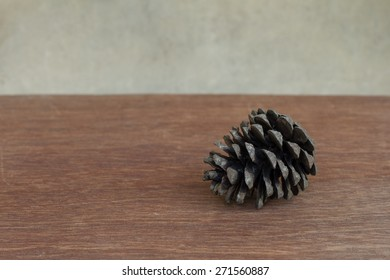 Pine cone on table and vintage background