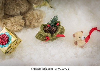 pine cones in a gift bag on snowy background, Christmas gift bag with pine cones