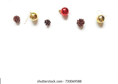 Pine cones, red and golden decorative balls. Christmas and New Year baubles on a white background. Mock-up, free space for text. Greeting card, banner, postcard. Minimalistic winter design. Flat lay