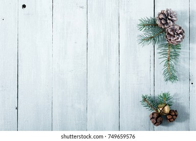 pine cones and twigs on white, purity Christmas background