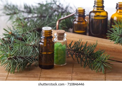 Pine essential oils and sea salt for aromatherapy