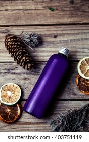 Pine grapefruit shampoo on wooden background. Organic and natural cosmetics for healthy and beautiful hair.