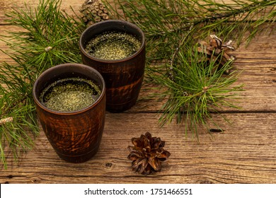 Pine needle tea, sollip-cha, traditional Korean beverage. Alternative medicine, healthy life style. Vintage wooden boards background