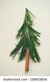 pine needles decorated with pearls and cinnamon quill - little christmas tree