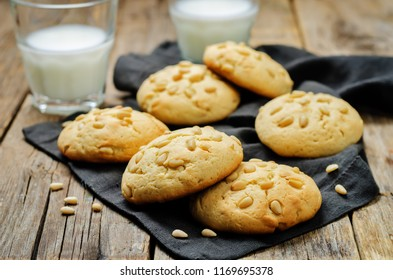 Pine nuts cookies with glasses of milk. Italian cuisine. toning. selective focus