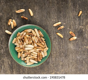 pine nuts on old wooden table, top view