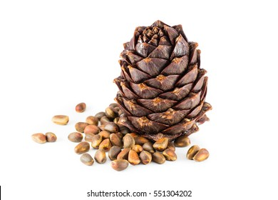 Pine nuts and ripe pine cone on a white background