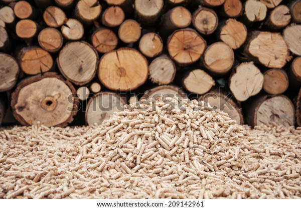 Pine pellets in front a wall of fire woods