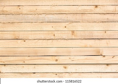 Pine Planks Stacked At Construction Site