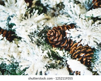 Pine tree decorated with cones for Christmas and New Year celebration. Holiday winter background.