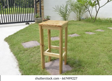 Pine wood chair in the garden