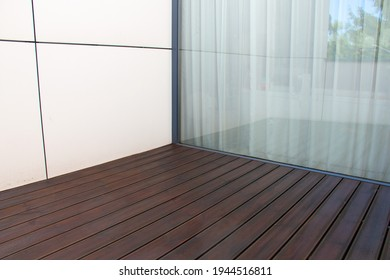 Pine wood deck, treated softwood decking terrace contrasting with white facade panels and large window, architecture detail of modern house design