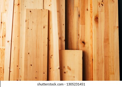 Pine wood floorboard planks in workshop ready to be used for hardwood flooring
