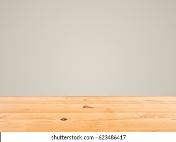 Pine wooden desk with color background and big copyspace.