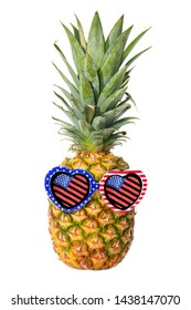 Pineapple. American Flag. Pineapple with American flag and American flag design sunglasses. Isolated on white. Room for text. Clipping path.