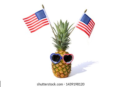 Pineapple. American Flag. Pineapple with American flag and American flag design sunglasses. Isolated on white. Room for text. Clipping path. 4th of July Concept. Summer fun concept.