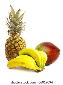 pineapple, bananas and mango on a white background