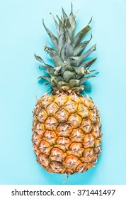 Pineapple  blue pastel background, lay flat overhead view, vibrant colors