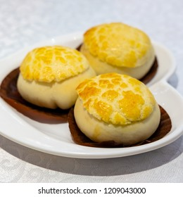 Pineapple bun pre-stuffed with barbecued pork, Barbecued pork pastry, (char siew sou)