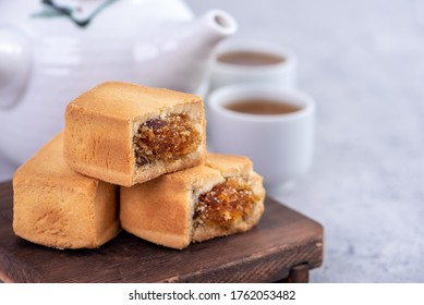 Pineapple cake pastry - Taiwanese famous sweet delicious dessert food with tea, close up, copy space design.