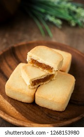 Pineapple cake is a sweet traditional Taiwanese pastry containing butter, flour, egg, sugar, and pineapple jam.