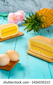 pineapple flavor sweet rolls with eggs and a pineapple on background on a blue table