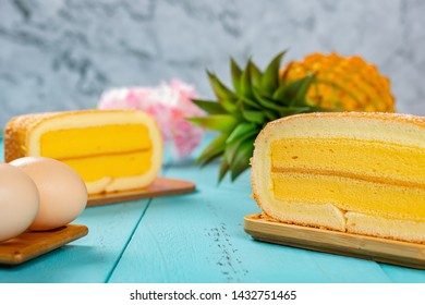 pineapple flavor sweet rolls with eggs and a pineapple on background on a blue table horizontal composition
