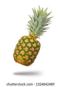 Pineapple floating in mid air with shadow isolate on white