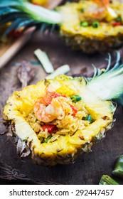 Pineapple fried rice shrimp on wooden table