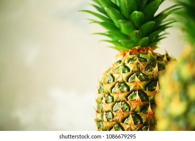 Pineapple fruit background. Close up of tropical pineapples texture. Summer, holiday concept. Raw, vegan, vegetarian, clean eating diet