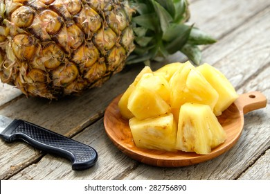 Pineapple fruit cut on wooden