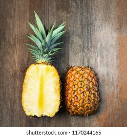Pineapple fruit cut two halves top wooden background negative space. Square Composition. Juicy organically grown ripe and sweet