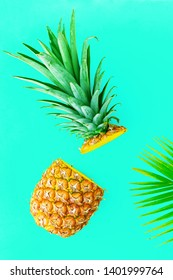 Pineapple fruit half cut on yellow color background, top view. Minimal summer food concept.