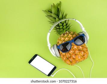 Pineapple fruit with headphones top view