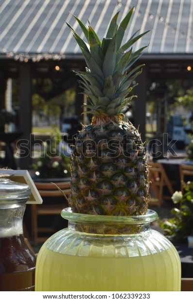 pineapple fruit on lemonade drink container