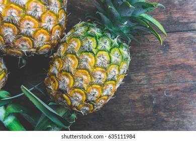 pineapple fruit on wood table