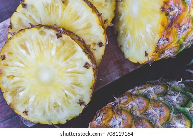 pineapple fruit on wood table , piece of fruit pineapple , fruit for healthy diet