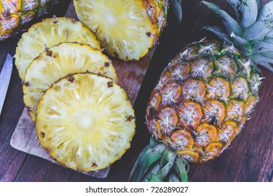 pineapple fruit on wood table , a piece of pineapple fruit , fruit for diet healthy