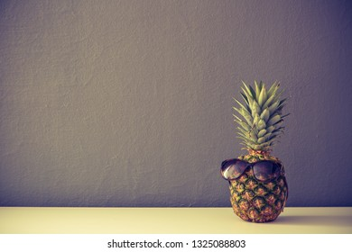 Pineapple with glasses with cross process filter